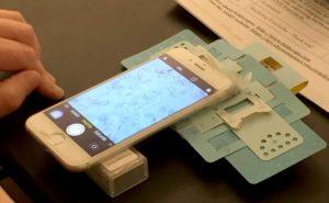 A closeup of phone and Foldscope